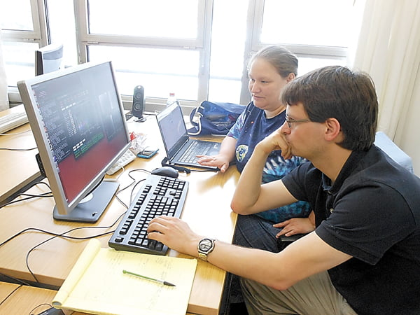 Marlinton native and West Virginia University junior Natasha McMann studies data with Dr. Joris Verbiest at the University of Bielefeld in Germany. McMann is spending the summer at the university studying data on Pulsar J1640+2224 and its companion white dwarf. Photo courtesy of Natasha McMann