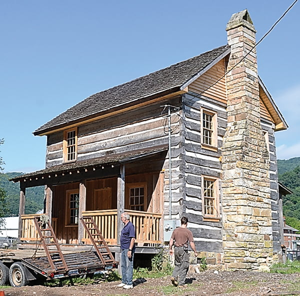 The McGlaughlin house, the oldest dwelling in Marlinton, is close to completion. Pictured outside the house are Pocahontas County Historic Landmarks Commission member Dennis Driscoll and contractor Colt Zendik. S. Stewart photo