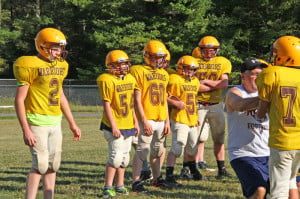 Head Coach J.R. Kiner teaches blocking techniques during Pocahontas County Middle/Junior football practice on Monday afternoon. The Middle/ Junior Warriors open their season at home on Tuesday, September 2 at 6 p.m. against Petersburg.
