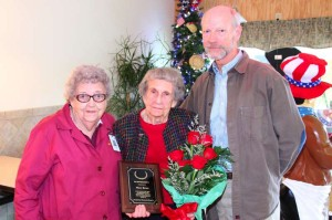 The Pocahontas Memorial Hospital Auxiliary held a luncheon at Dorie's Restaurant on Monday to celebrate the group's 42 years of service to the hospital. The Auxiliary raises money for PMH through various activities, including the Christmas Love Lite Tree, the PMH Gift Shop and community health fairs. Several Auxiliary and PMH officers attended the luncheon, including Auxiliary President Doris Jean Weatherholt, PMH CEO Barbara Lay and PMH Board of Trustees President Dr. Robert Must. During the event, special honors were bestowed upon Mary Broce to recognize her 26 years and more than 5,000 hours of volunteer service to the residents of Pocahontas County. In the photo, left to right, Weatherholt, Broce and Must.