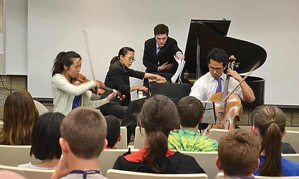 """Garth Newel Music Center students performing """"Trio (1998) for violin, cello and piano,"""" composed by Pierre Jalbert, are the Meadowlark Piano Trio, from left:Janny Joo, April Sun and Timothy Paek. Jason Mooney, center, assisted Sun by turning the pages of her music during the performance. S. Stewart photo"""