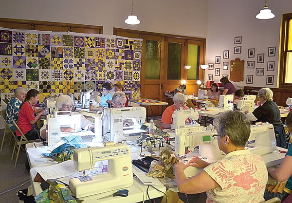 The sound of sewing machines buzzed through the Oak Grove Presbyterian Church last weekend during the annual Pearl S. Buck quilting party. Quilters gathered to learn new patterns and spend quality time with like-minded crafters. On the wall in the background is a display of squares made by participants. They all feature purple pansy fabric. The squares were part of a drawing where lucky quilters won 20 squares for a quilt top or three squares for a table runner. S. Stewart photo