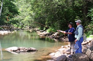 Former Army paratrooper Bucky Tarring casts a line into the Elk River during a visit to Elk Springs Resort last week. Beside Taring is Fred Bell, a Dominion employee and volunteer fishing guide.