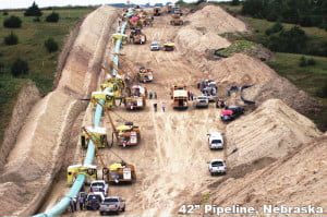 Construction of a 42-inch pipeline in Nebraska. A 150-foot right-of-way is necessary during construction and a permanent 75-foot, clear-cut right-of-way remains after construction. Photo courtesy Greenbrier River Watershed Association.