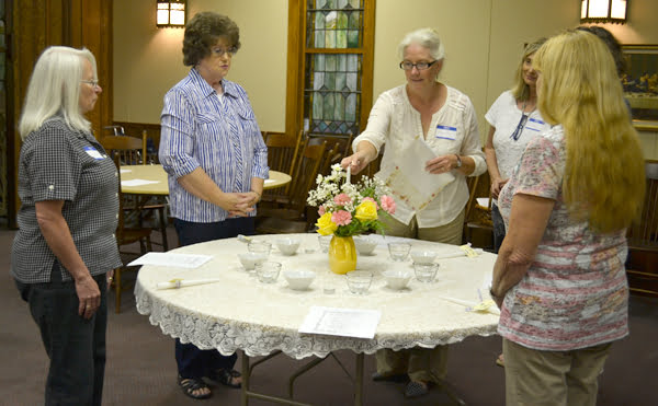 At the Marlinton Woman's Club meeting September 4, Margaret Worth, center, led the officer installation ceremony. From left, Wally Clark, standing in for treasurer Dotty Mitchell, secretary Phyllis Lucas, Worth, former president Laura Dean Bennett, president Michelle Bubnis and vice president Cindy Sabota. S. Stewart photo