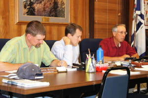 The Pocahontas County Commisssion in session on Septembe 2, 2014. Left to right: Commissioners Jamie Walker, David Fleming and William Beard.