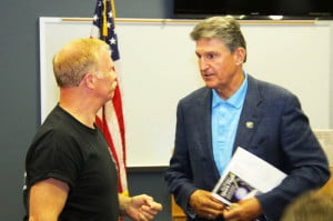 Senator Joe Manchin, right, speaks with a National Radio Astronomy Observatory (NRAO) employee during an economic forum in Green Bank on August 26. Manchin talked about different funding options to keep the Green Bank Telescope and research center open. The National Science Foundation, which funds the NRAO, is seeking partnerships with univerisites to help fund the facility.