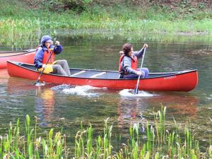 Participants in the DNR Become an Outdoorswoman program row a canoe across Watoga Lake on Saturday. Sixty women from across West Virginia attended the popular program this weekend. DNR instructors taught a variety of classes, including fishing, hunting, mountain biking, photography,stream ecology and several other topics.