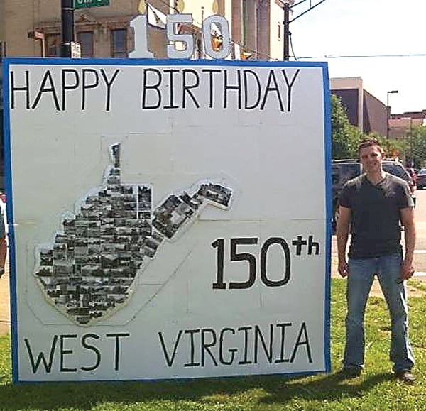 Although he wasn't born in West Virginia, former Pocahontas County resident Wayne Worth considers the state home and holds it in a special place in his heart. Above, Worth in 2013 with a birthday card he made for the sesquicentennial celebration. Photo courtesy of Wayne Worth