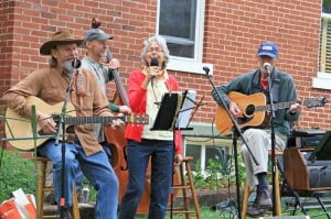 Rush Run Philharmonic performs during the Women and the Arts event at Locust Hill Inn in Marlinton on Saturday. Pictured, l-r: Patrick Gabbert, Bob Must, Ginger Must and Phil Rolleston.