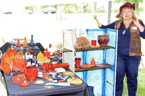 Cynthia Guerreri shows off her ceramic wares during Saturday's craft show.