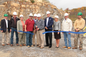 Several state and local officials attended a ribbon-cutting ceremony for a new lime plant at the Boxley quarry in Mill Point last Thursday. In the photo, West Virginia Agriculture Commissioner Walt Helmick cuts the ribbon at the new plant. Pictured, left to right: Greenbrier Valley Conservation District Chairman Tim Van Reenen, West Virginia Conservation Agency Director Brian Farkas, Marlinton Recorder Robin Mutscheller, Mill Point Supervisor Howard Walker, Delegate Bill Hartman, Helmick, State Senator Greg Tucker, Delegate Denise Campbell, Agriculture Department Eastern Operations Director Mike Teets and Pocahontas County Commissioner Jamie Walker.