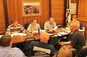 Several firefighters attended the Pocahontas County Commission meeting last Tuesday and requested that the Commission institute a $60 per household fire fee in the county. The commission deferred action on the request until more information is obtained. In the photo, Marlinton Fire Association President Herb Barlow speaks to the Commission.