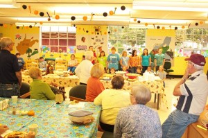 Hillsboro Elementary School students sing a song during an open house at the Hillsboro Senior Center last Friday afternoon. The center held the open house to celebrate its new expanded space in the former school cafeteria.