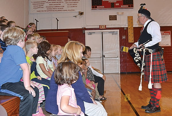 Monroe County resident Don Dransfield gives a presentation on the Scots-Irish influence on Appalachia to the students at Hillsboro Elementary School last week. Dransfield played several types of bagpipes and shared information on the style of music created by immigrants in West Virginia. S. Stewart photo