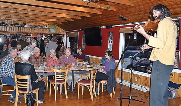 Fiddler Paolo Marks performs for a crowd of nearly 90 people at the FiddleFare fundraiser for the Pocahontas County Opera House last Friday at The Fiddlehead. Marks was one of four fiddlers to perform at the event. S. Stewart photo