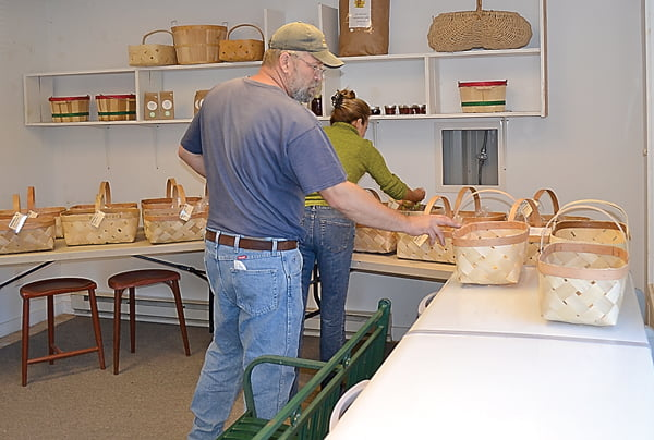 Produce on the Move partners Steve Saffel and Dawn Baldwin-Barrett prepare subscribers baskets at the former Pocahontas Woods building in Marlinton. S. Stewart photo