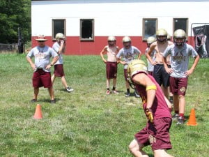 PCHS football coach Doug Burns supervises on the first day of football practice for the 2014 season.