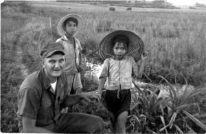 Homer Hunter with two Vietnamese children near Danang in 1965. While serving as a Marine in Vietnam, Corporal Hunter helped a Catholic missionary start a laundry service at a refugee camp, which enabled the camp to make money and support thousands of refugees, who were fleeing communist invaders. Homer Hunter pictures.