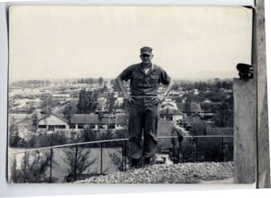 Corporal Homer Hunter on duty at a guard post in Danang, South Vietnam in 1965. The city of Danang is in the background.
