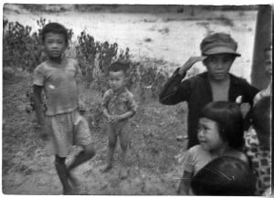 Corporal Homer Hunter took this picture of impoverished Vietnamese children in 1965. Hunter worked to establish a laundry operation at a refugee camp, which allowed the camp to become self-sufficient and provide food and clothing to families displaced by a communist invasion of South Vietnam.