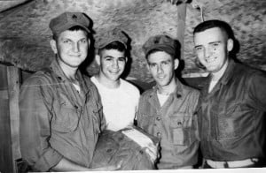 Homer Hunter with fellow Marines in the Third Marine Division in Danang in 1965. Hunter was assigned to a small headquarters unit that managed ammunition and other supplies. On a supply run to Danang, Hunter and two of these Marines would have a chance encounter that resulted in a major, successful humanitarian project. Pictured, left to right: Hunter, Lance Corporal Joe Kettler, Sergeant Rusnak and Lieutenant Dean.