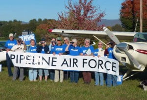 Members of the Dominion Pipeline Monitoring Coalition pose with one of the three aircraft the group plans to use to monitor construction activity with the proposed Atlantic Coast pipeline.