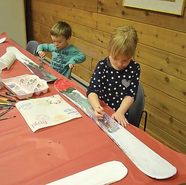 Children at Linwood Daycare channeled their creativity as they painted old skis in a class offered by Kristen LeCroy. Above, James Monico and Zara Fanning mix unique color creation. Most of the children said they are using their skis as signs for their bedrooms. S. Stewart photo