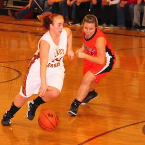 PCHS senior Tristin Day avoids a Richwood defender in a Lady Warrior victory on December 19.