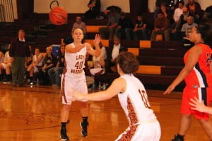 PCHS senior Natalie Hartzell passes to teammate junior Melissa Murphy in the Lady Warriors' victory over Richwood.