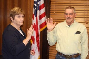 Pocahontas County Commission Assistant Sue Helton administered the oath of office to incoming Commissioner David McLaughlin at the start of Tuesday evening's Commission meeting. McLaughlin, a farmer from the Dunmore area, will represent the county's northern district for a six-year term.