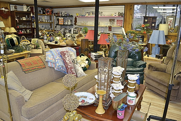 Whether it's furniture, decorations or construction supplies, the Linwood Emporium has a little bit of everything. Above, a couch and two recliners make a mock-up living room, complete with coffee table and miscellaneous decorations.