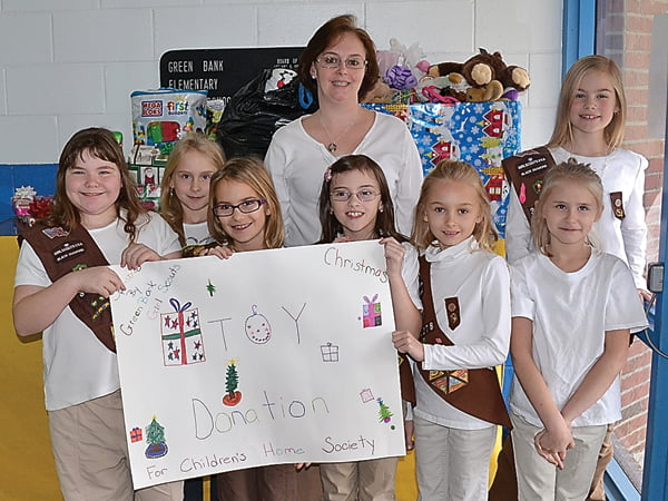 The Green Bank Girl Scouts held a toy drive at Green Bank Elementary-Middle School for the Children's Home Society in Lewisburg. The troop, front row, from left: Emilynn Hall, Mileya Bircher, Madeline Ray, Olivia Vandevender and Adelyn Warner. Back row, from left: Maybelle Warner, leader Susan Ray and Jillian Fortney. Not pictured: Leaders Rita Fortney and Kelly Warner. S. Stewart photo