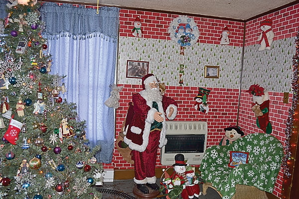 The living room of  Wilbur and Linda Wright's home in Marlinton is decked out for Christmas with a large tree, trains, Santa and snowmen galore. The wonderland is created for their grandchildren. S. Stewart photo
