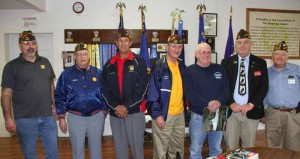 West Virginia Veterans of Foreign Wars District 10, which includes Pocahontas County, held a business meeting on Sunday afternoon. During the meeting, the group discussed a proposed VFW re-districting in West Virginia, which would reduce the number of districts from 10 to five. In the photo, left to right: Post 4484 Quartermaster John Wickline, Post 4484 Chaplain Nathan Nutter, District 10 Commander Bill Sanford, Post 4484 Commander and Past State Commander Kelly Goddard, Randy Facemire, State Junior Vice Commander Bob Kish and Summersville Post Commander Jim Moyer. Not pictured: Marlinton Post 4595 Commander Geoff Hamill. G. Hamill photo.