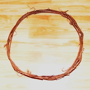 The wreath ring is made by making a braided coil out of grape vine or flexible saplings.