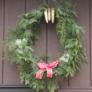 A homemade wreath is a one-of-a-kind creation and a fun family project. This West Virginia pine wreath, adorned with fern fronds, pine cones and lichen, was made for less than five dollars. The only store-bought materials needed for the project were wire, a ribbon to make a bow, and gold spray paint.