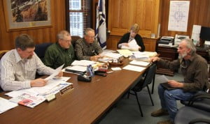 Cass resident John Fitzgerald talks to the Pocahontas County Commission about a proposed lease of land at the Green Bank Industrial Site. Fitzgerald said he wanted to lease 30 acres at the site for agricultural purposes. Pictured, left to right: Commissioners Jamie Walker, David McLaughlin and William Beard, Commission Assistant Sue Helton and Fitzgerald.