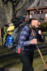 Steve Young walks through Marlinton on December 30. The Virginia retiree has walked more than 25,000 miles during the past seven years to raise awareness of the Victory Junction Gang Camp in Randleman, North Carolina. The camp provides fun camping experiences for children with chronic medical conditions and serious illnesses.
