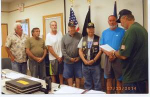 Charter officers of the Pocahontas County Chapter of Vietnam Veterans of America receive the chapter charter from West Virginia VVA Second Vice President Rodney Farley. Pictured, left to right: Richard Groseclose, Lee Wolfe, Arnold Dulaney, Joseph Smith, Norris Long, David Stone and Farley.