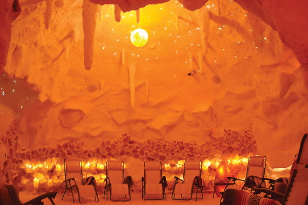Photos by Suzanne Stewart The halo therapy room, or salt cave, at The Salt Cave and Spa in White Sulphur Springs, may glow like it is on fire, but the room is slightly chilled due to the salt in the air. The room is sandblasted with Himalayan salt and the floor is covered in loose rock salt. Visitors take a seat in one of the reclining chairs, snuggle up under a blanket and simply inhale and exhale while listening to soothing music.