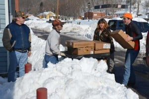 Volunteers for the Family Resource Network in Marlinton help unload boxes of groceries at the FRN office on Monday. Every month, the Pocahontas County FRN, Senior Citizens and Durbin Food Pantry receive a food delivery from the Mountaineer Food Bank in Gassaway. Pictured, left to right: George Sewell, Randy and Lisa Bibb, and Tommy Gruelick.