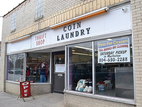 Marlinton residents Mark and Jamie Strauss recently bought the Marlinton Laundromat and reopened the business under the name Clean Cow Coin Laundry. The business is a laundromat and thrift shop combined. S. Stewart photo