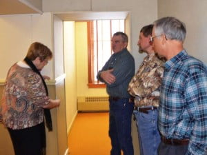 The Pocahontas County Commission and Commission Assistant Sue Helton inspect the second floor of the courthouse on Tuesday morning. Helton took the lead in advocating for major upgrades on the floor, including new carpeting and painting. The total cost of the upgrades exceeds $33,000. Pictured left to right: Helton and Commissioners David Mclaughlin, William Beard and Jamie Walker.