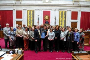 Several Pocahontas County elected representatives and officials attended the first Pocahontas County Day at the State Capitol last Friday. Among the attendees were Delegates Denise Campbell and Bill Hartman, Commissioners William Beard and David McLaughlin, Marlinton Mayor Joe Smith and Hillsboro Mayor Anne Walker. In the photo, Speaker of the House Tim Armstead presents a certificate  proclaiming Pocahontas Day to Sherry McCarty, with the National Radio Astronomy Observatory.