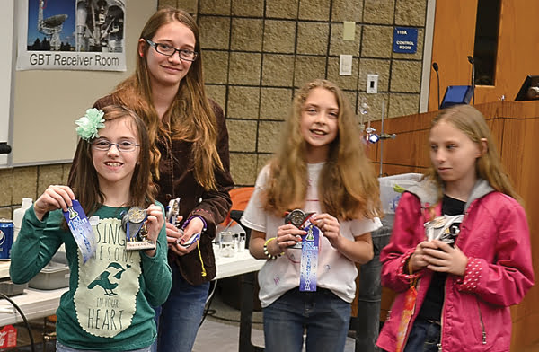 Overall winners at the Pocahontas County Science Fair were, from left:first place tie, Madeline Ray and Irish Simmons; second place, Sarah Warder; and third place, Daphne Hilleary. S. Stewart photo