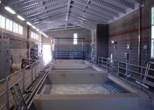 Construction of a Snowshoe wastewater system is on-track to begin by June 1. The wastewater treatment plant will utilize membrane biological reactor (MBR) technology, which produces very clean effluent water. Utilizing microfilters, MBRs eliminate the need for secondary clarifiers and tertiary treatment and alloew a plant to be built with a smaller footprint. In the photo, an enclosed MBR treatment plant. Siemens Corporation photo.