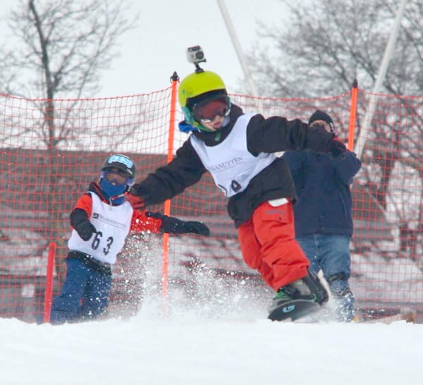 Eight-year-old Tristen O'Steen snowboarding in a recent competition at Massanutten Resort in Virginia. Photo courtesy of Valerie O'Steen