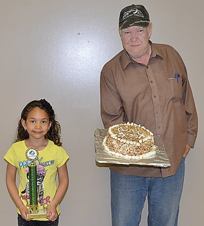 Best in Show, Penelope Campbell. Marlinton Mayor Joe Smith purchased Campbell's cake at the auction. S. Stewart photos