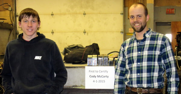 Pocahontas County High School senior Cody McCarty, left, recently received certification in welding from teacher Dervin Lambert, right. Not pictured: senior Birch Loudermilk, who also certified in welding. Photo courtesy of Cammy Kesterson